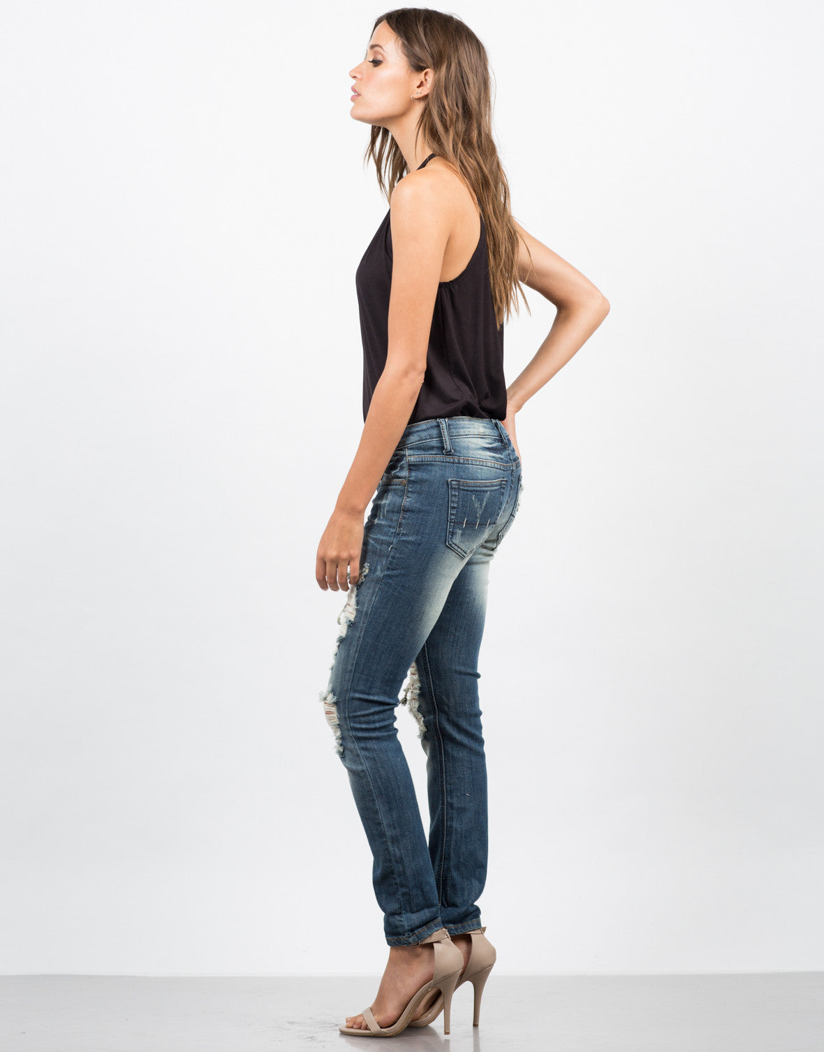 Side View of Dark Wash Destroyed Ankle Jeans