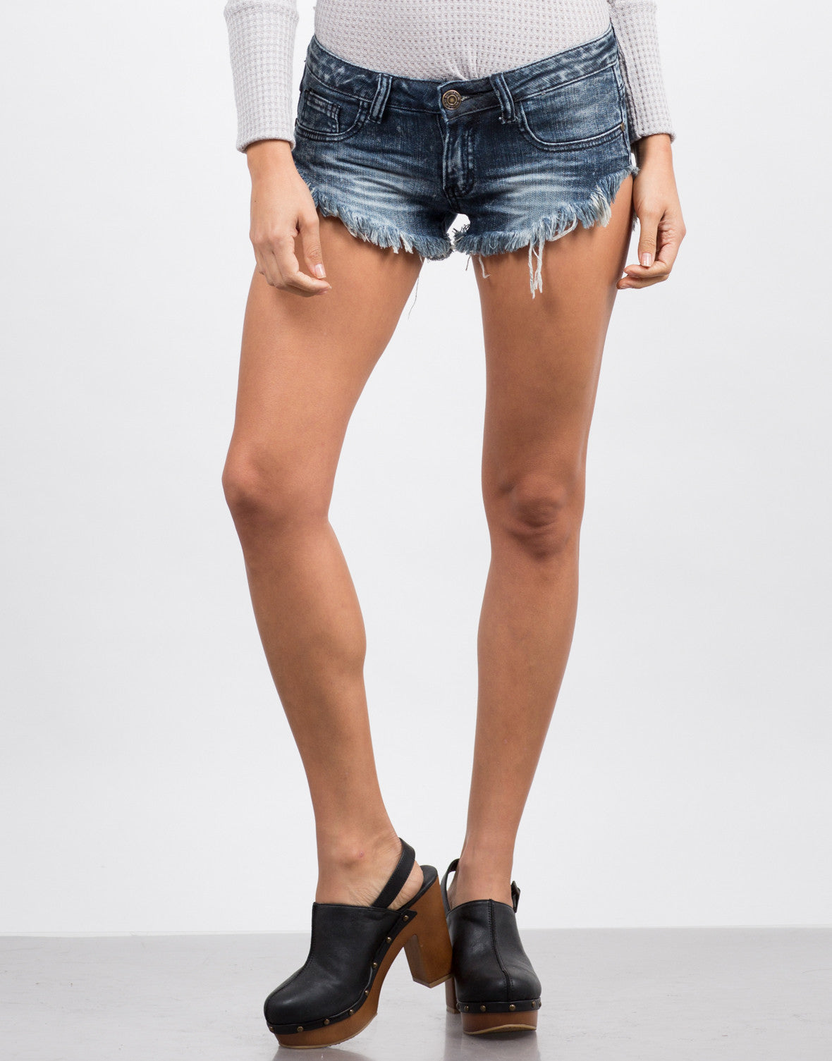 Front View of Dark Wash Fringed Shorts