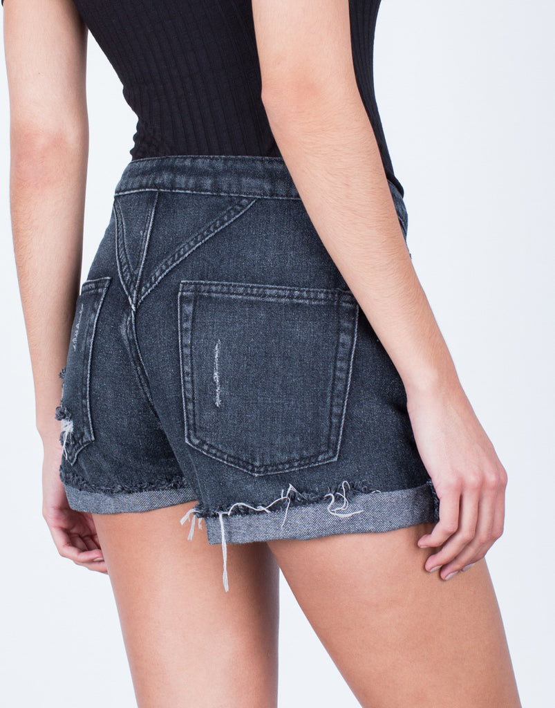 Detail of Destroyed Buttoned Denim Shorts