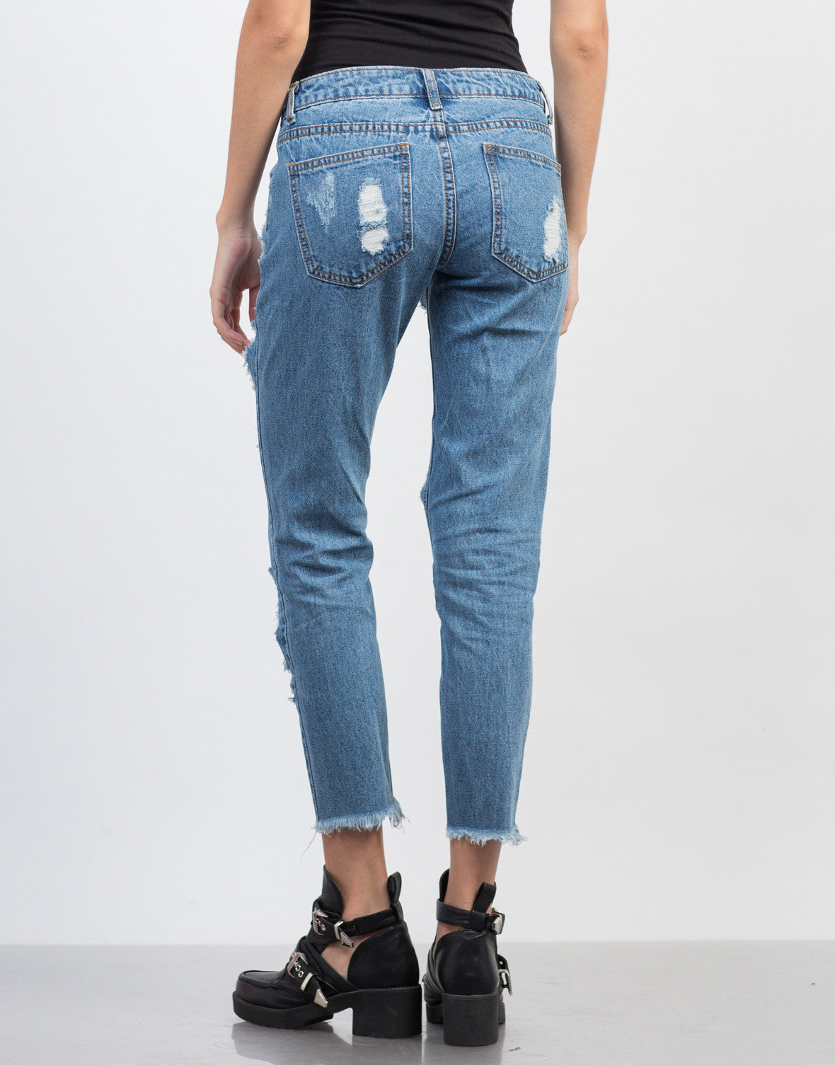 Back View of Destroyed Cropped Hem Jeans