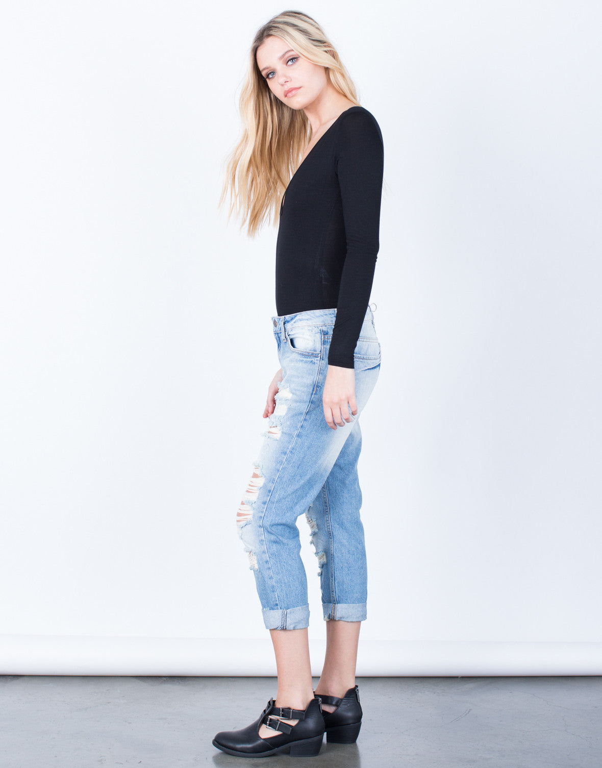 Side View of Destroyed Slim Straight Denim Jeans