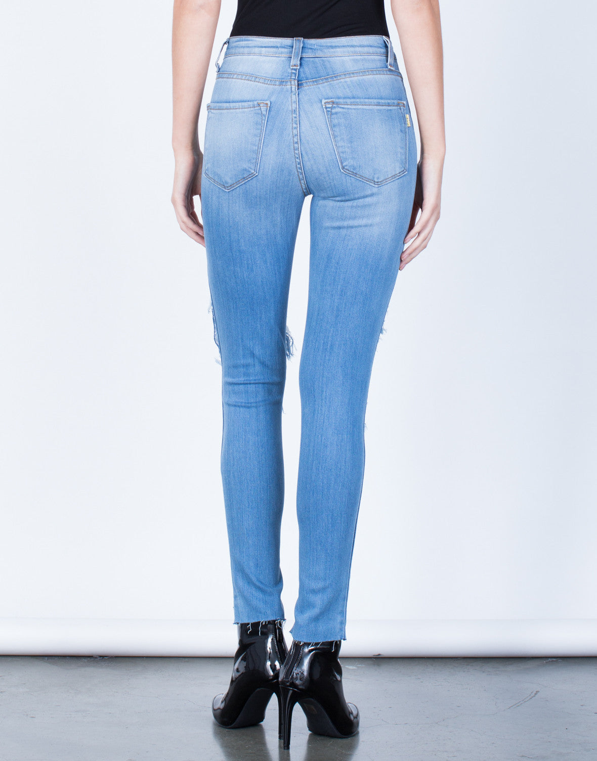 Back View of Destroyed Step Hem Jeans