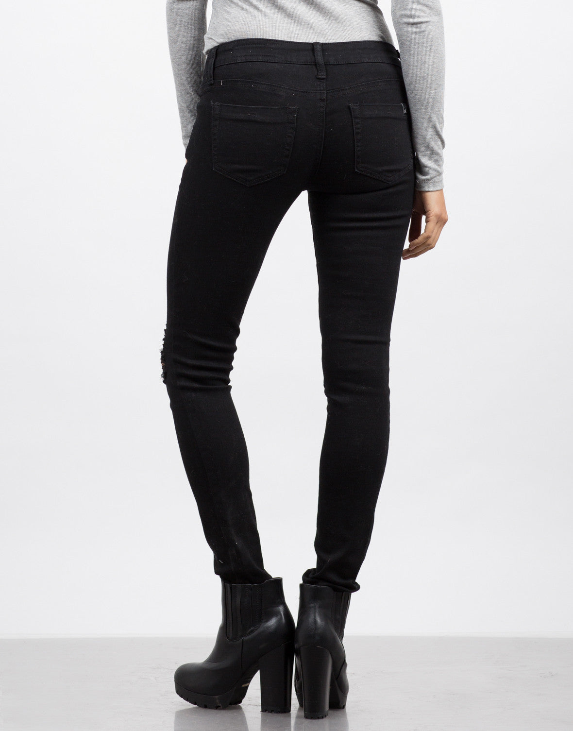 Back View of Destroyed Black Skinny Jeans