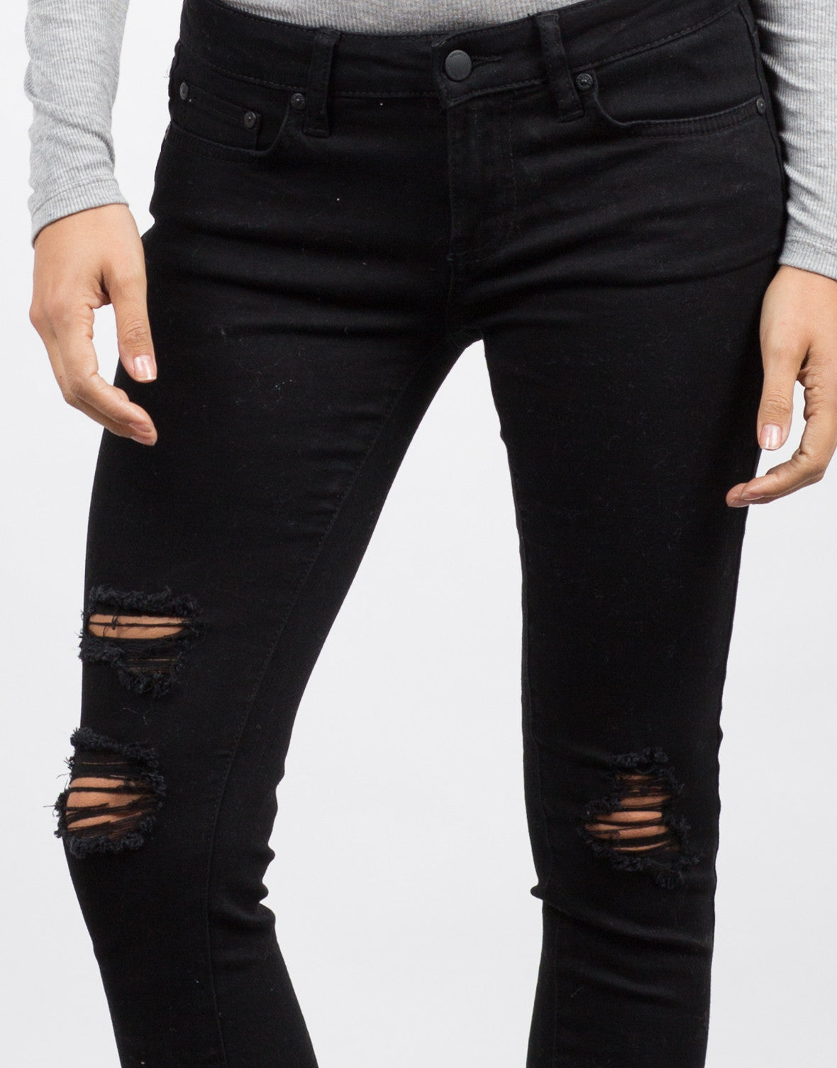 Detail of Destroyed Black Skinny Jeans