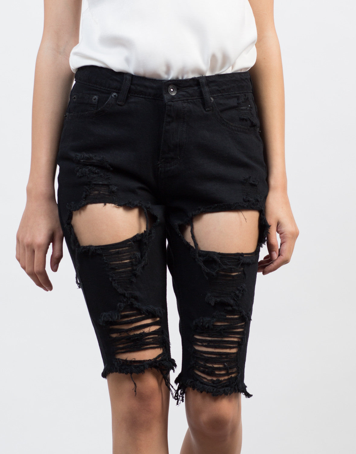 Detail of Distressed Black Bermuda Shorts