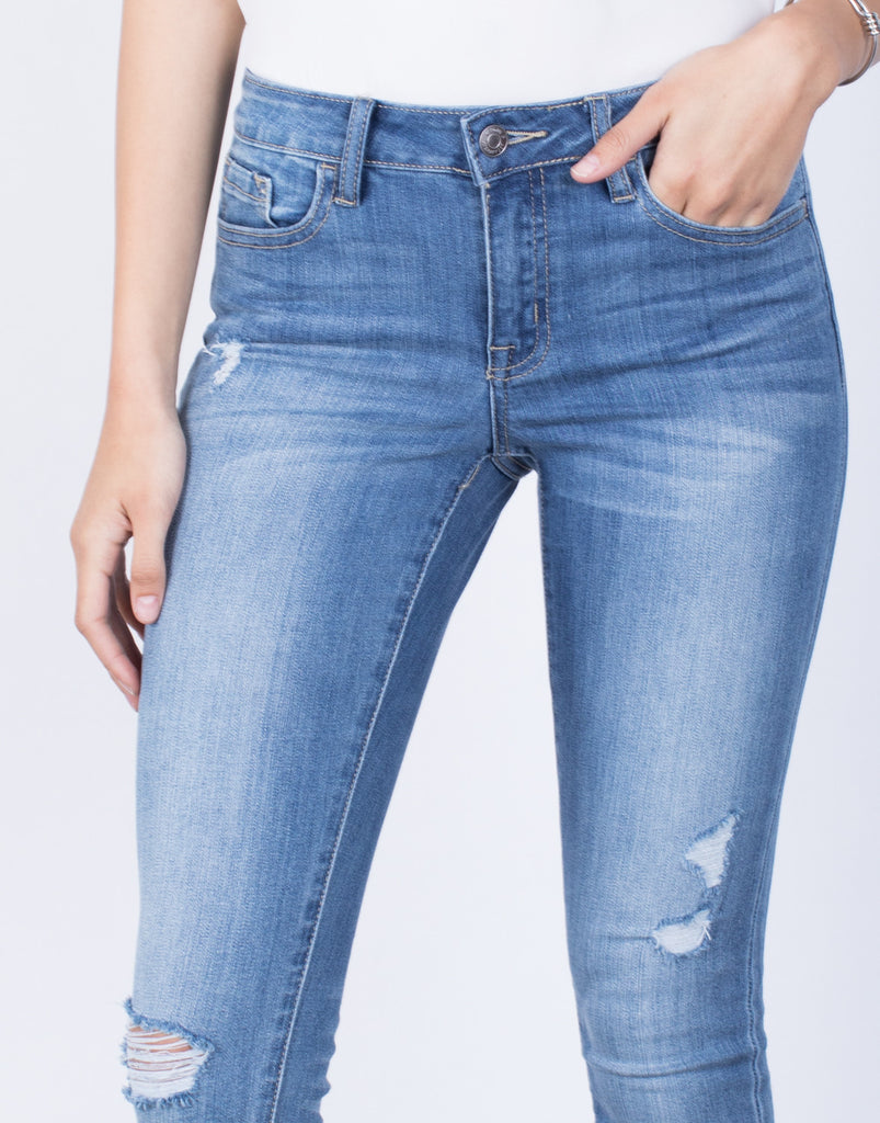 Detail of Distressed Hem Jeans