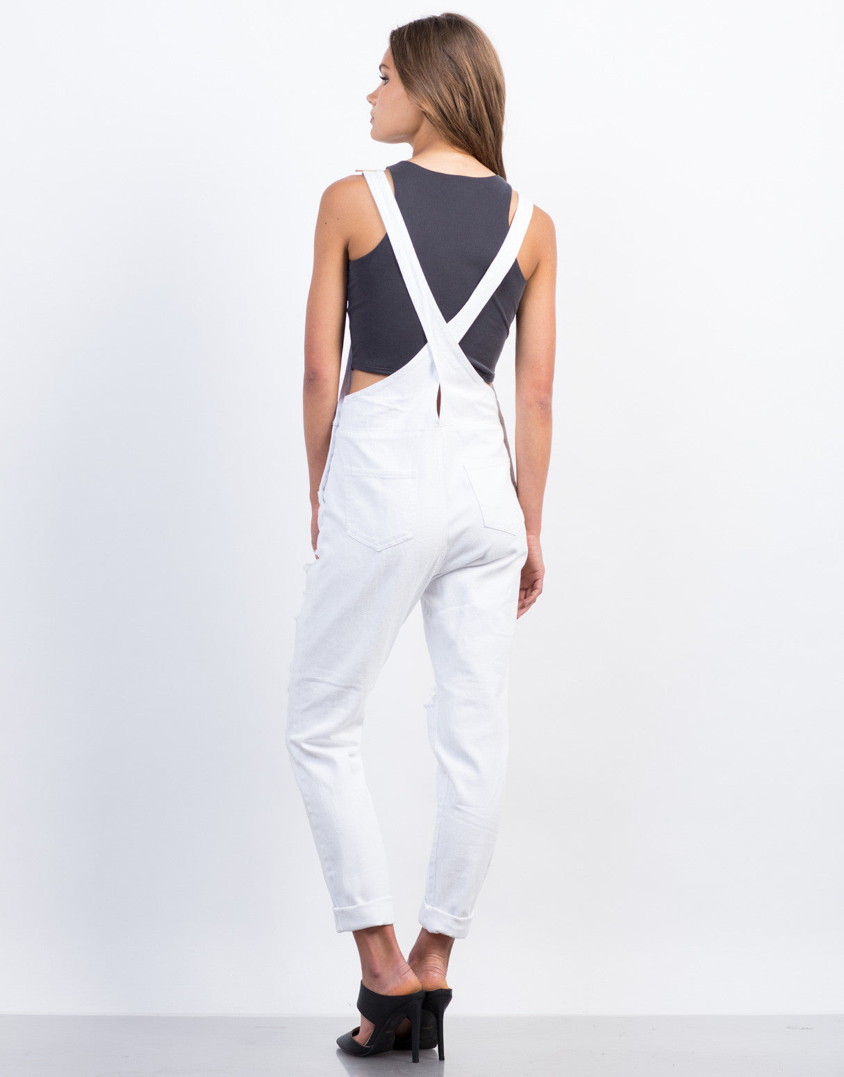 Back View of Distressed White Denim Overalls