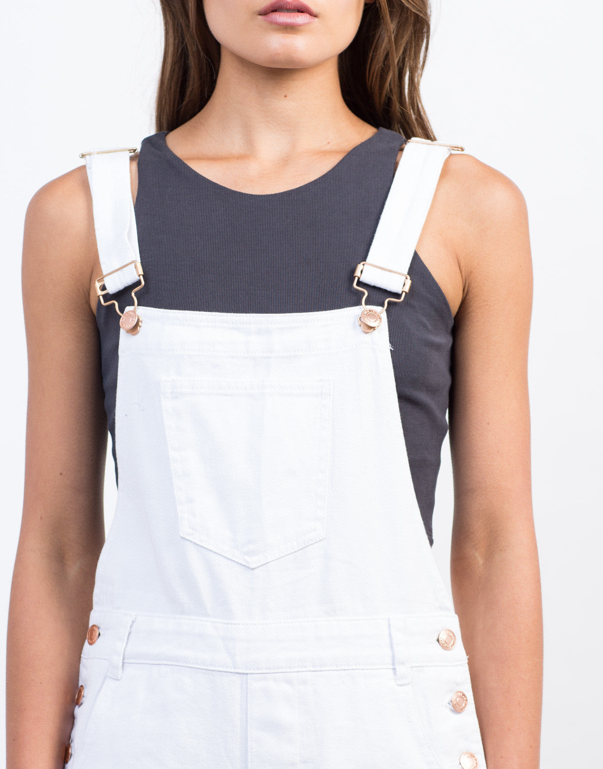 Detail of Distressed White Denim Overalls