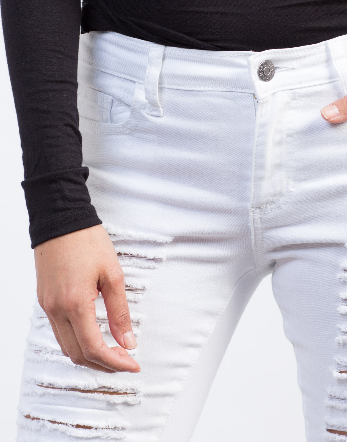 Detail of Distressed White Skinny Jeans