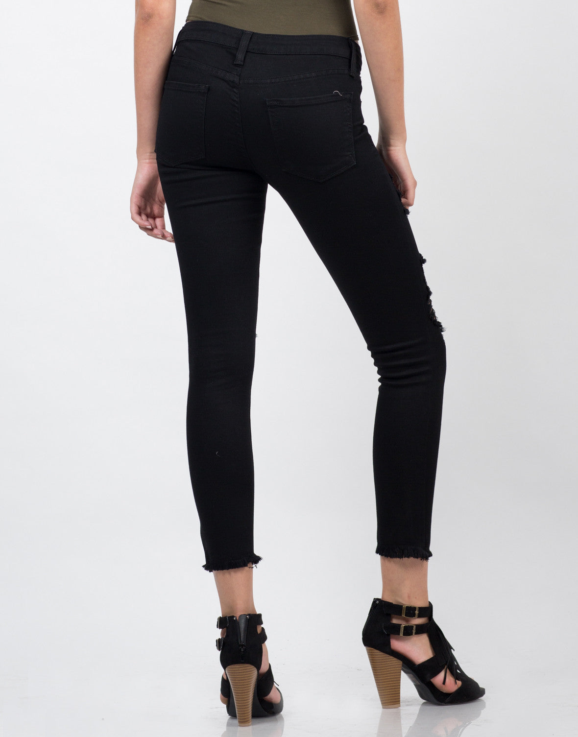 Back View of Distressed Fray Hem Skinny Jeans
