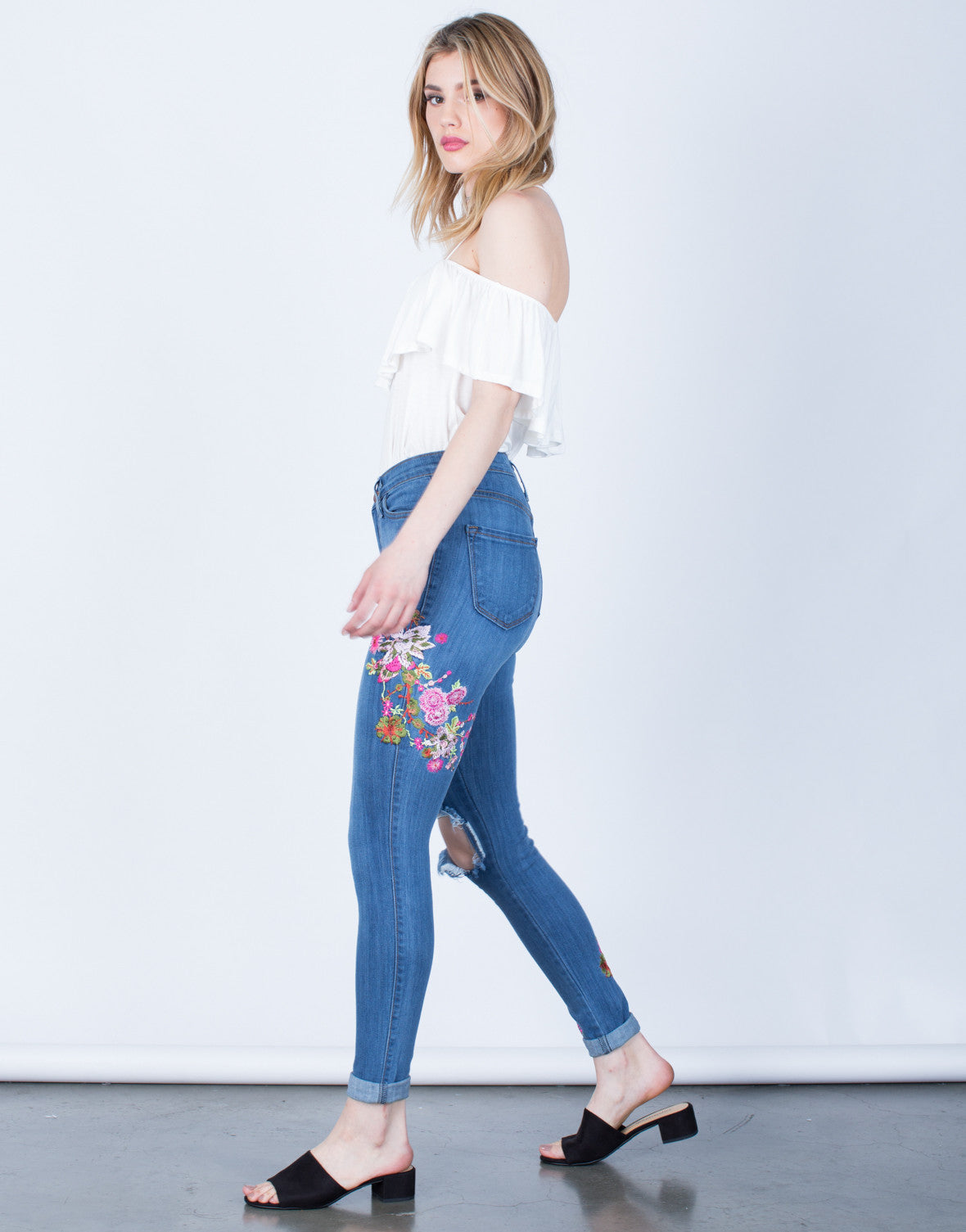 Side View of Floral Embroidered Jeans