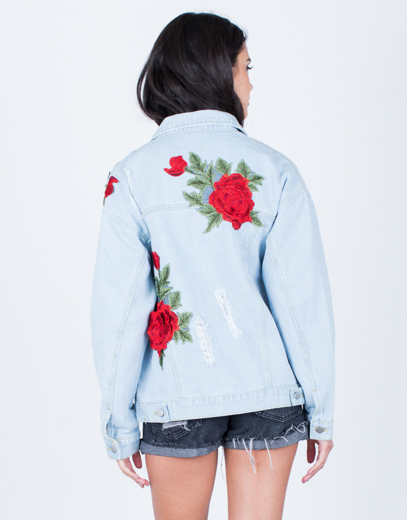 Back View of Floral Patched Denim Jacket