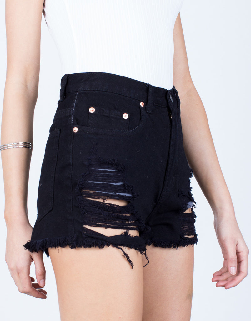 Detail of Frayed and Destroyed Denim Shorts