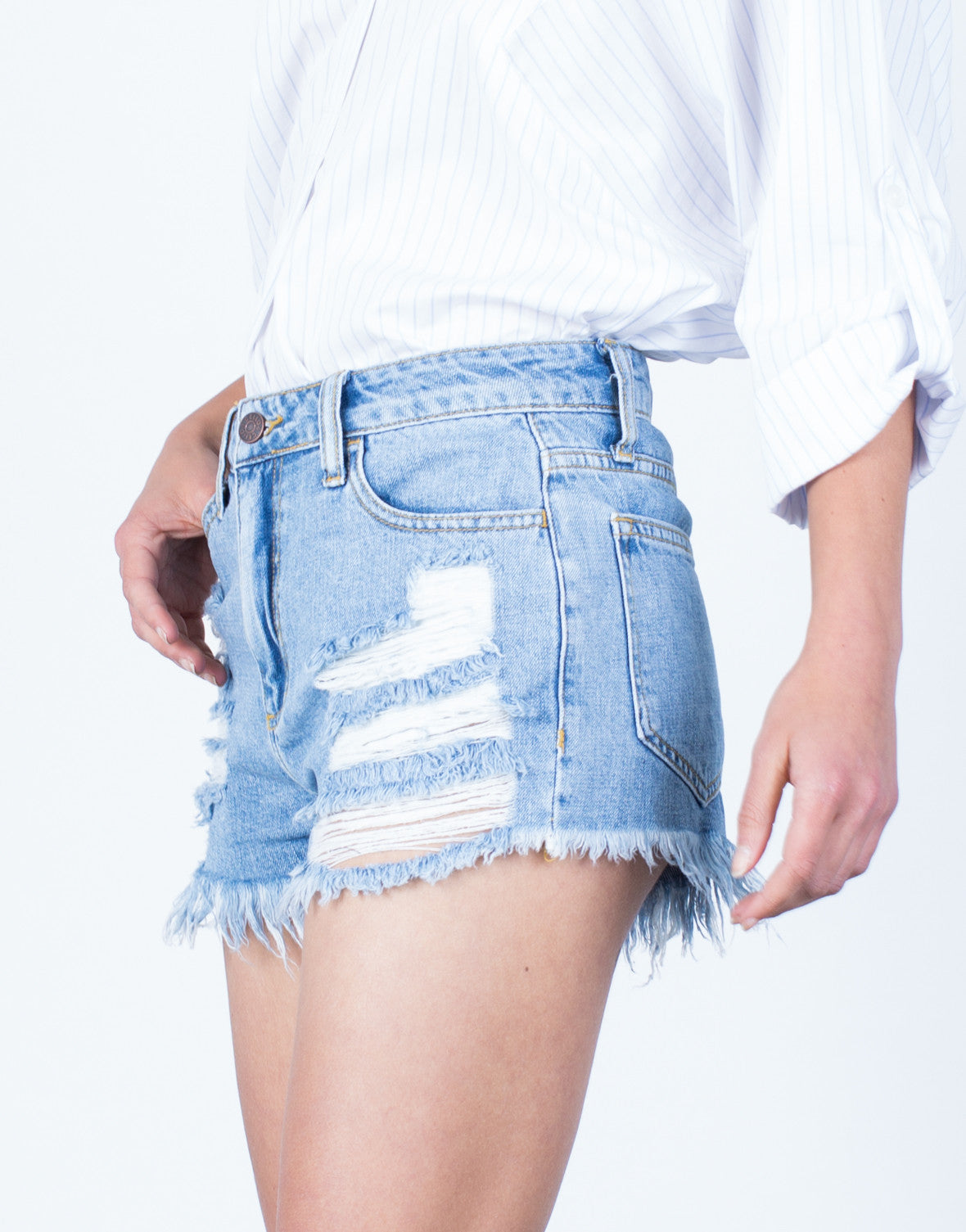 Detail of Frayed and Ripped Denim Shorts