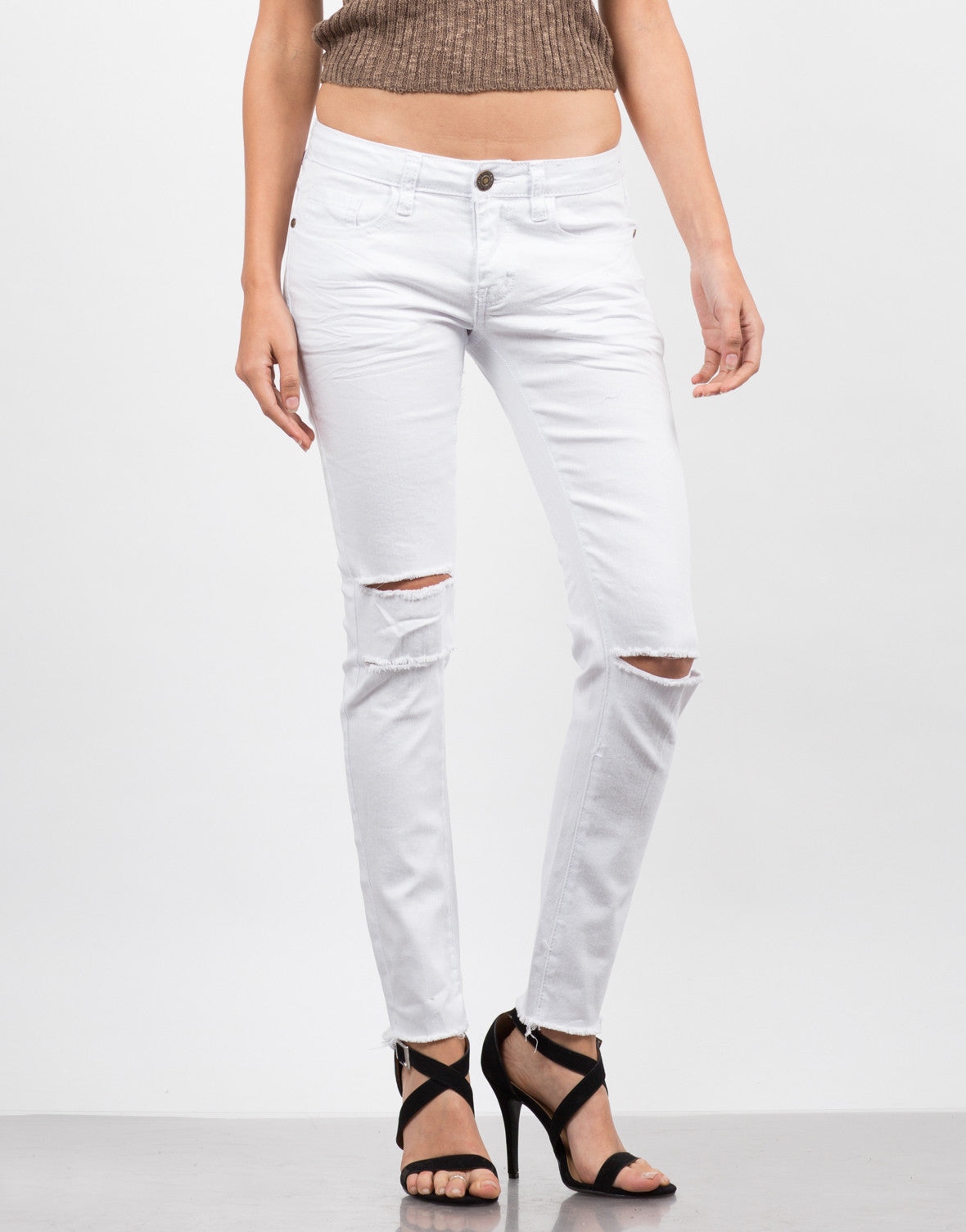 Front View of Frayed Hem Ripped Skinny Jeans