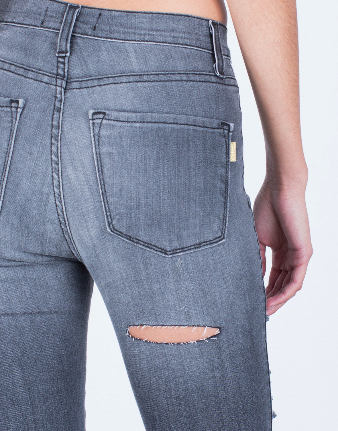 Detail of Front Shredded High Waisted Jeans
