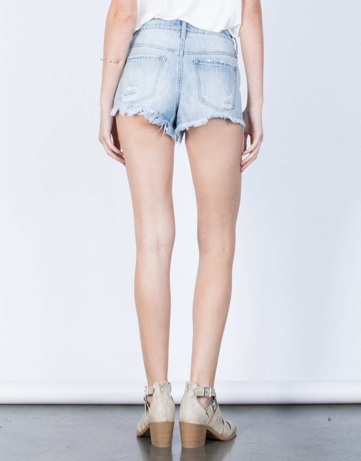 Back View of Fun in Frayed Shorts