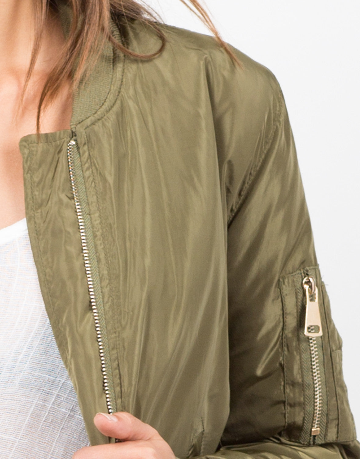 Detail  of Gold Zippered Bomber Jacket