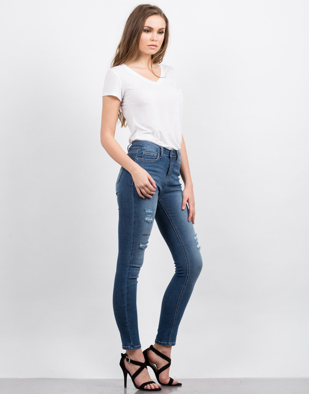 Side View of High Waisted Destroyed Jeans