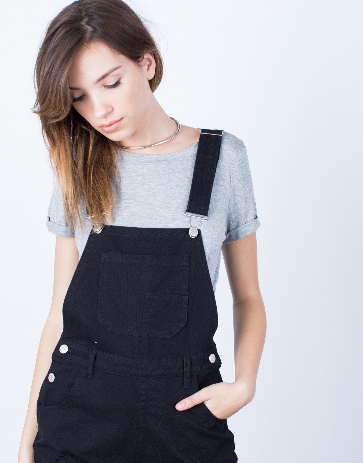 Detail of Holey Denim Overalls