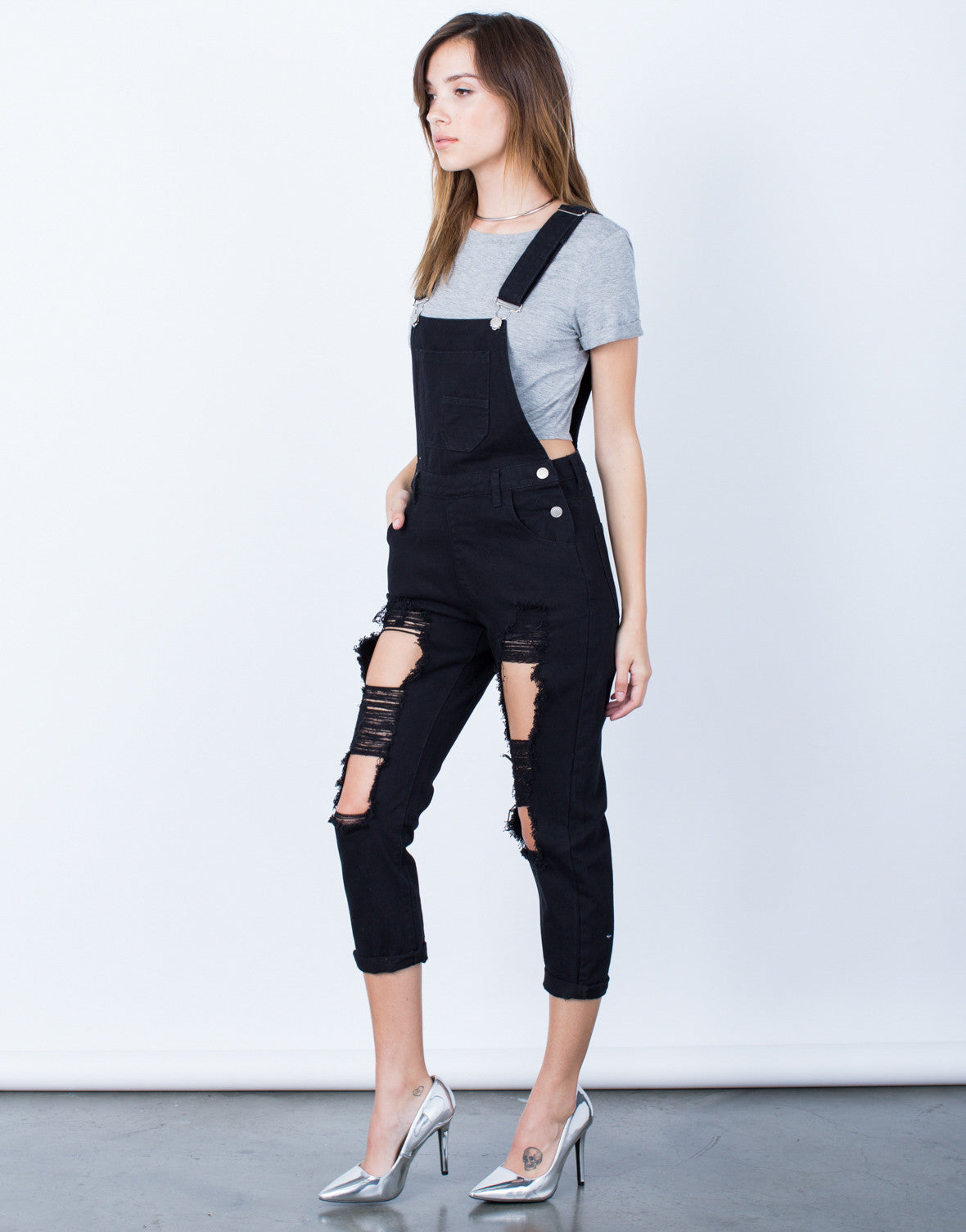 Side View of Holey Denim Overalls