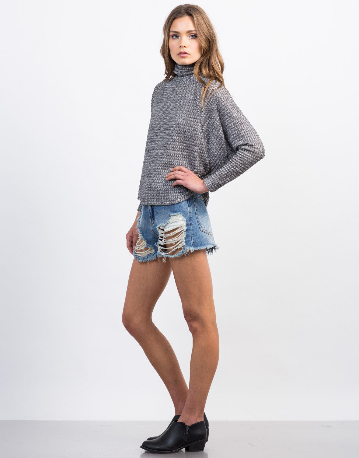Side View of Knitted Flowy Turtleneck Top