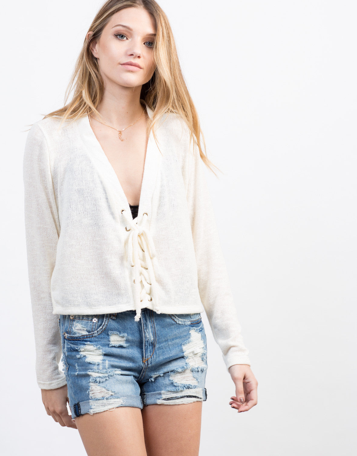 Detail of Knitted Lace-Up Sweater Top