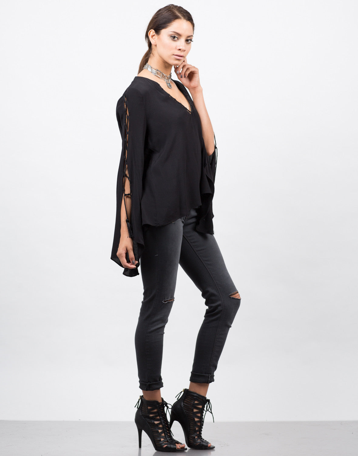 Side View of Lace Up Tassel Blouse