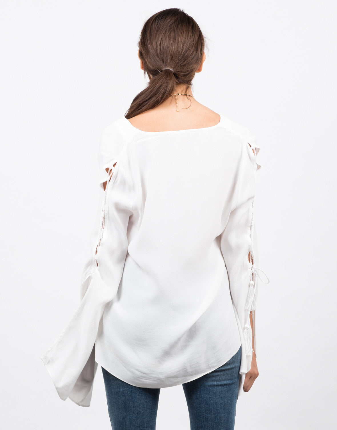 Back View of Lace Up Tassel Blouse