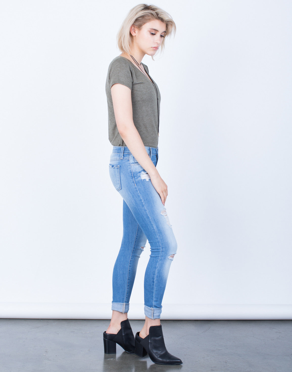 Side View of Lightly Destroyed Light Blue Skinny Jeans