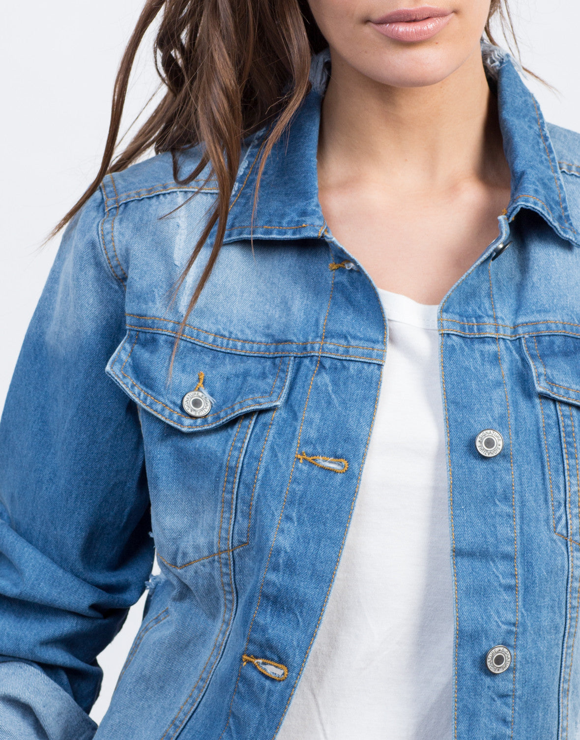 Detail of Lightly Distressed Denim Jacket