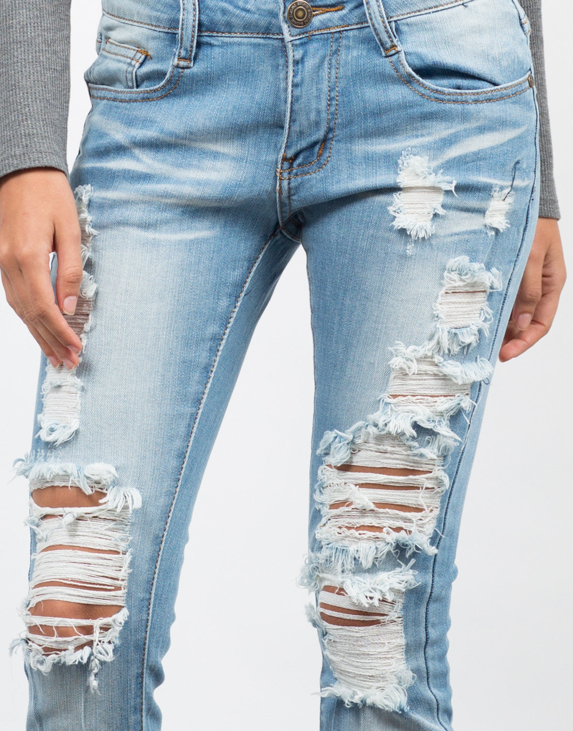 Detail of Light Wash Destroyed Ankle Jeans