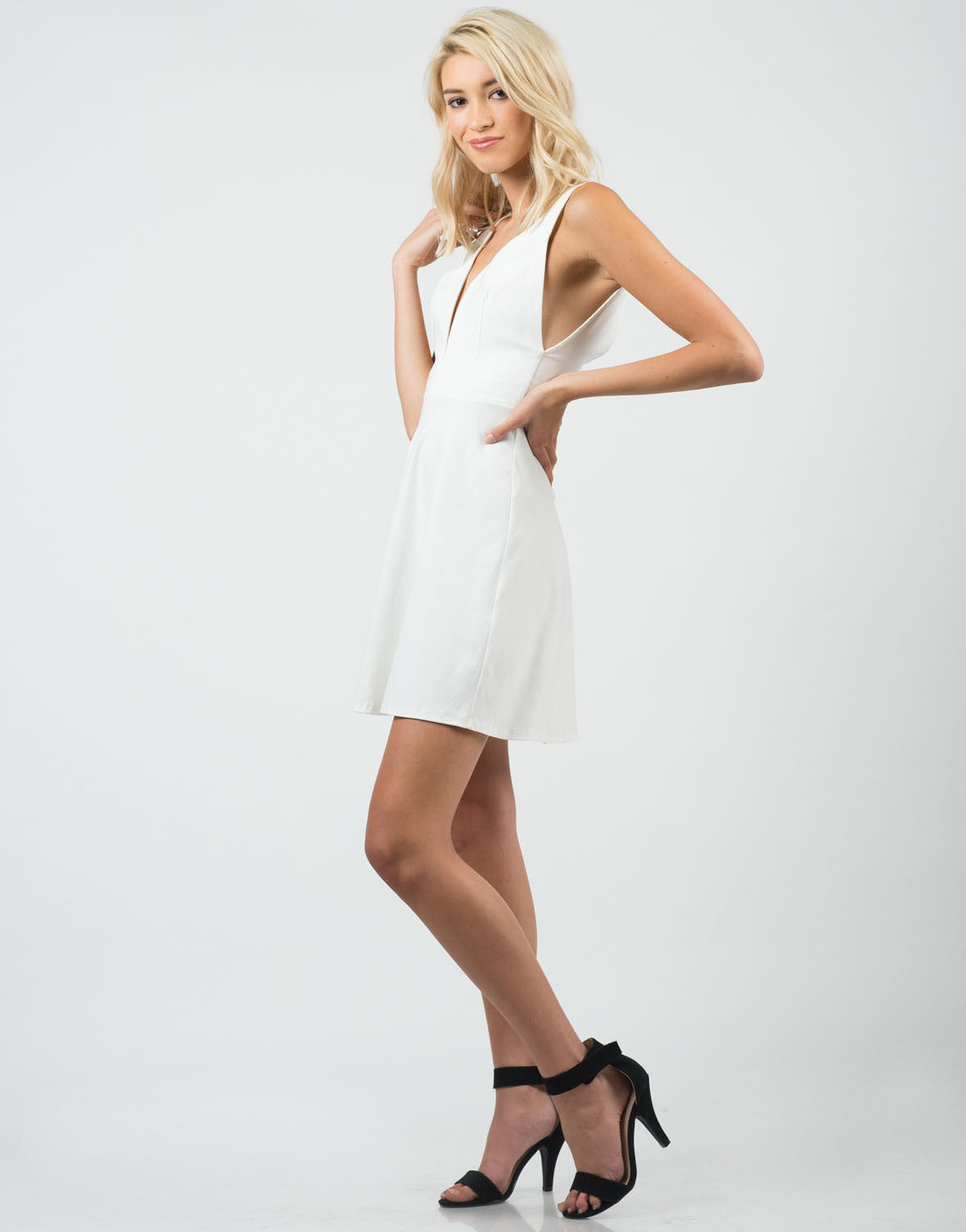 Side View of Little White Flared Dress