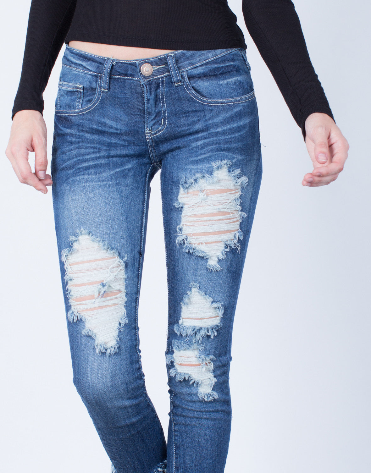 Detail of Medium Wash Destroyed Skinny Jeans