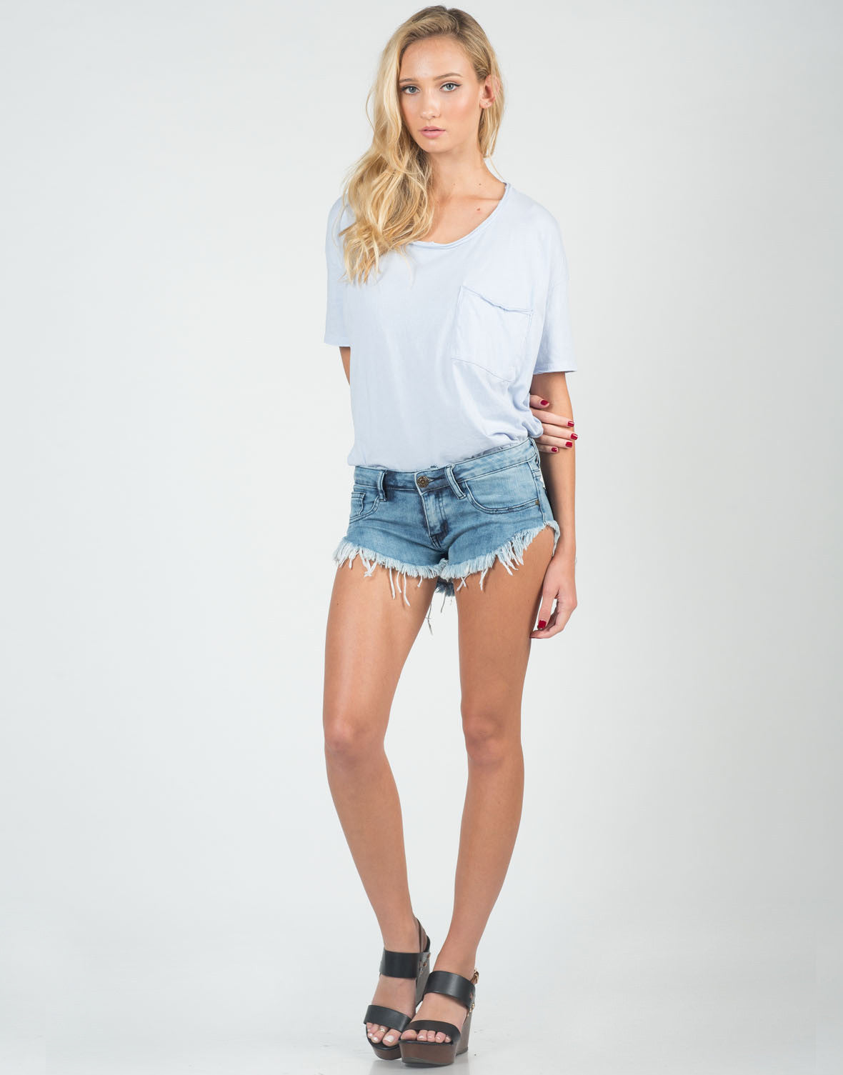 Front View of Medium Washed Frayed Denim Shorts