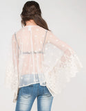 Back View of Meshy Daisies Poncho Top