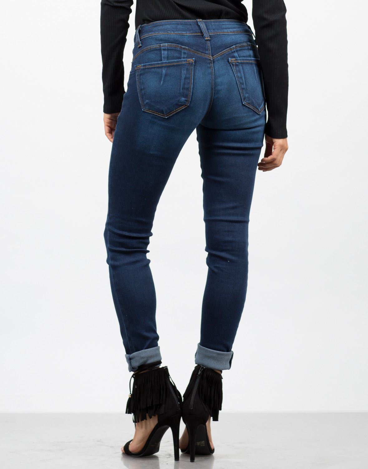 Back View of Mid-Rise Faded Jeans