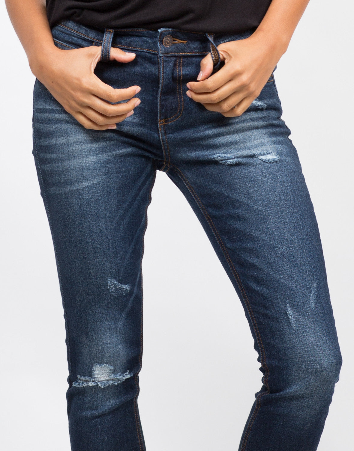 Detail of Mid-Rise Released Hem Jeans