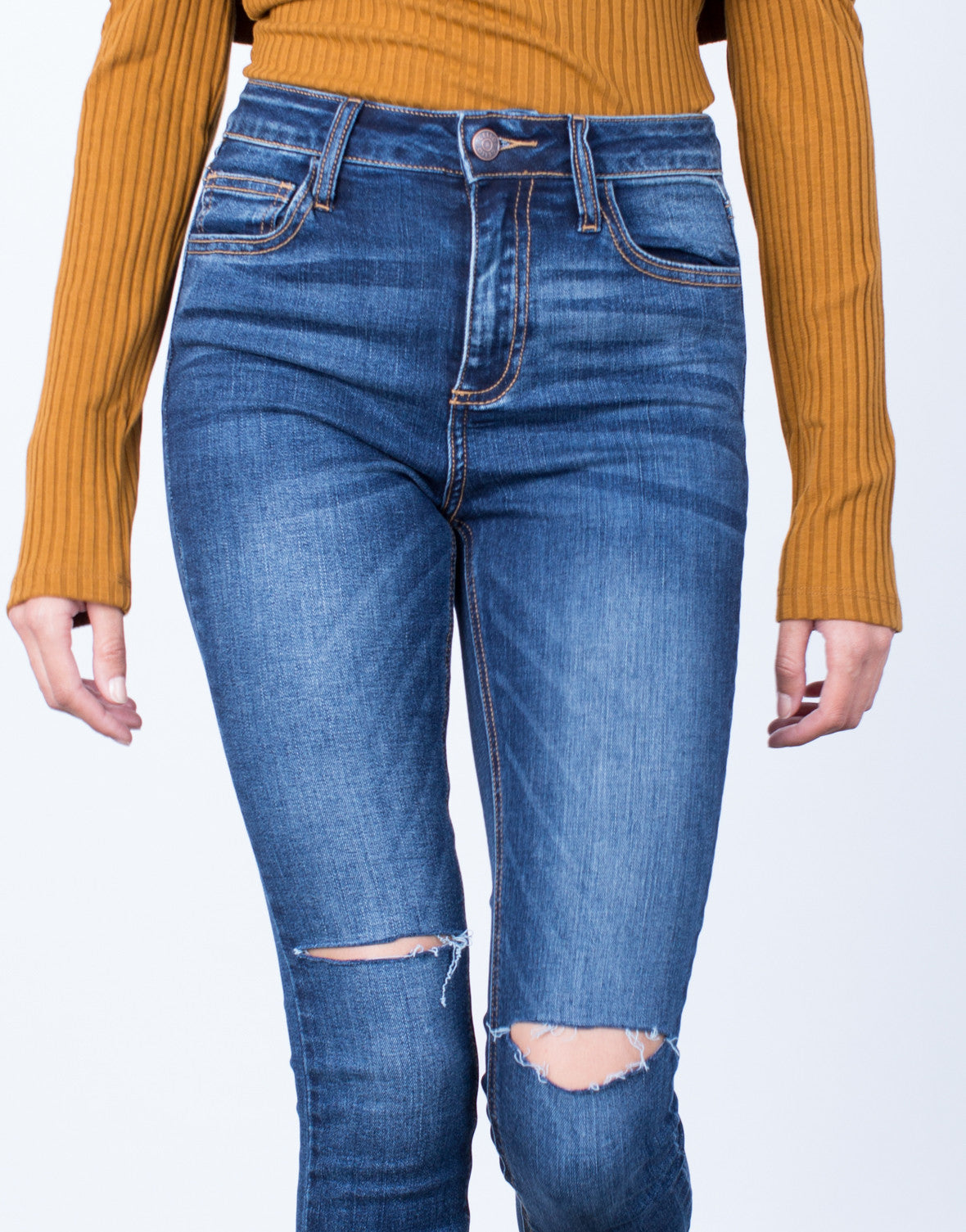 Detail of One Slit High Waisted Jeans