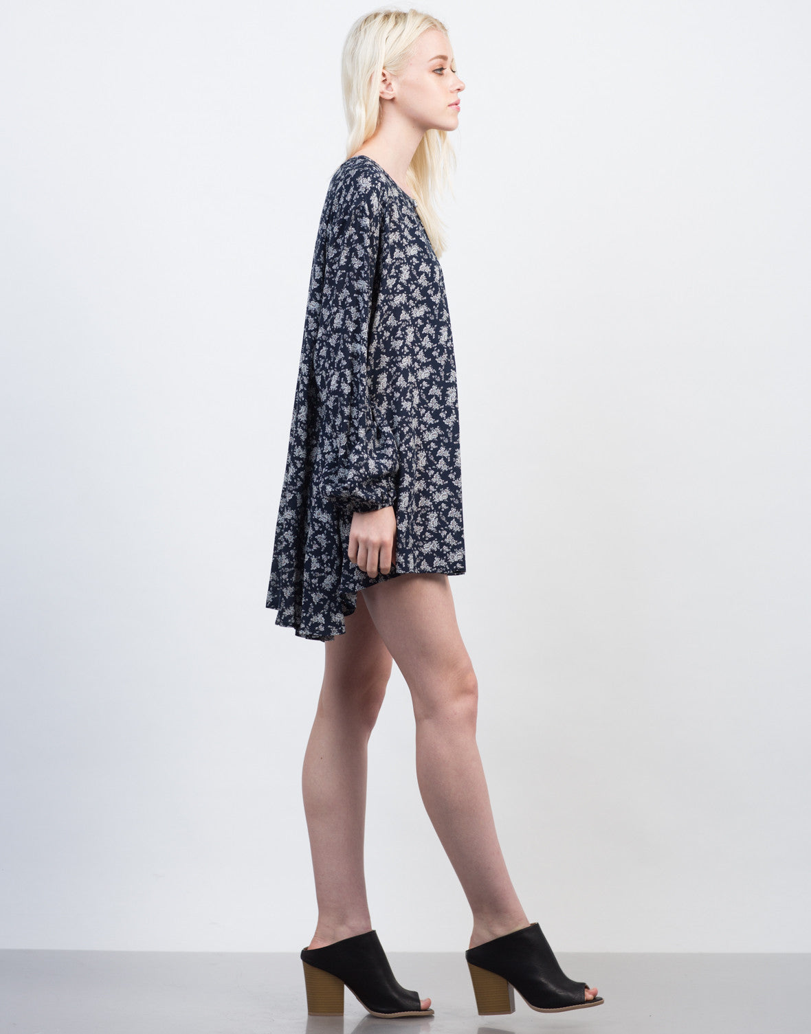 Side View of Overflowing Floral Tunic Top