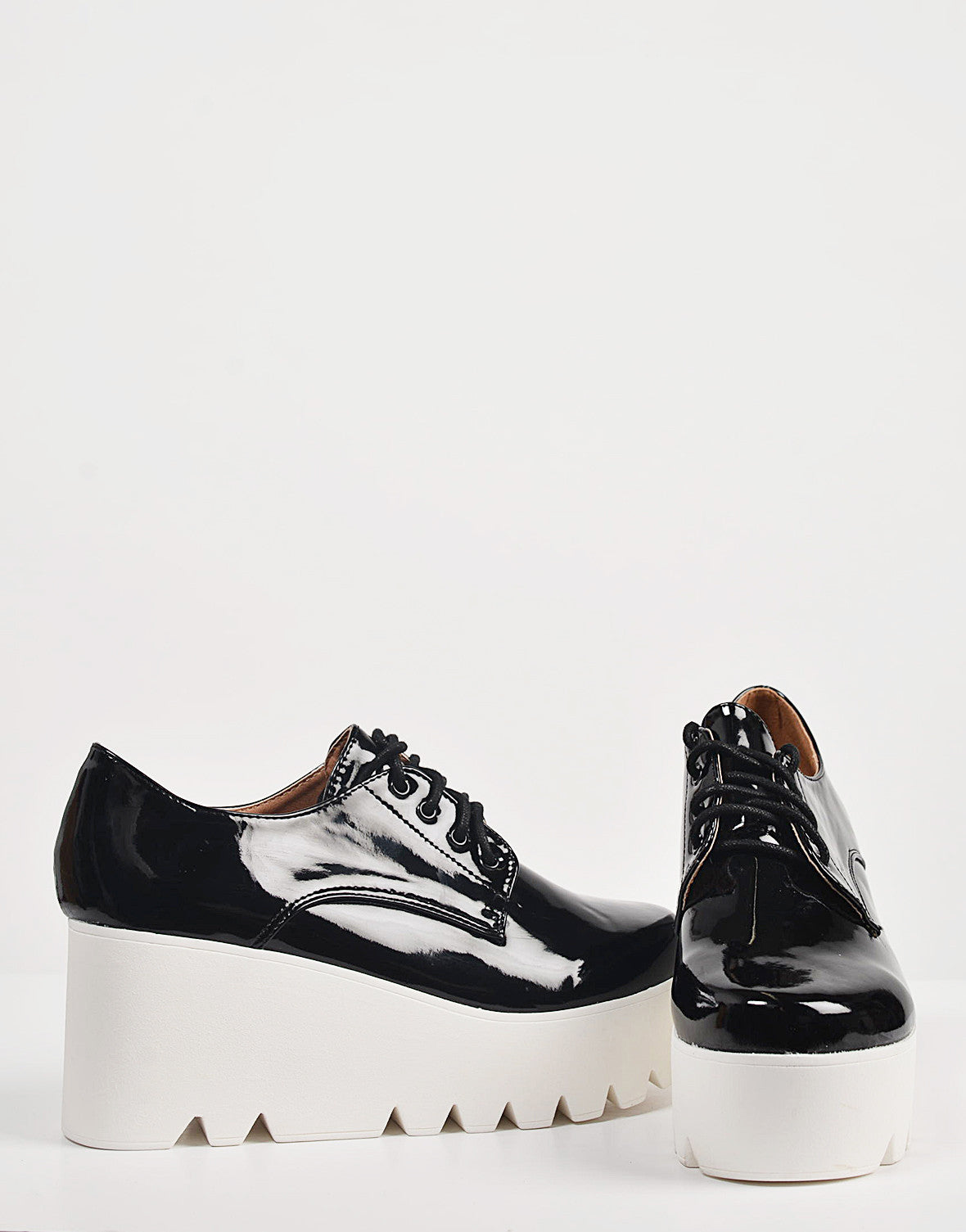 Detail of Patent Laced Up Flatform Oxfords