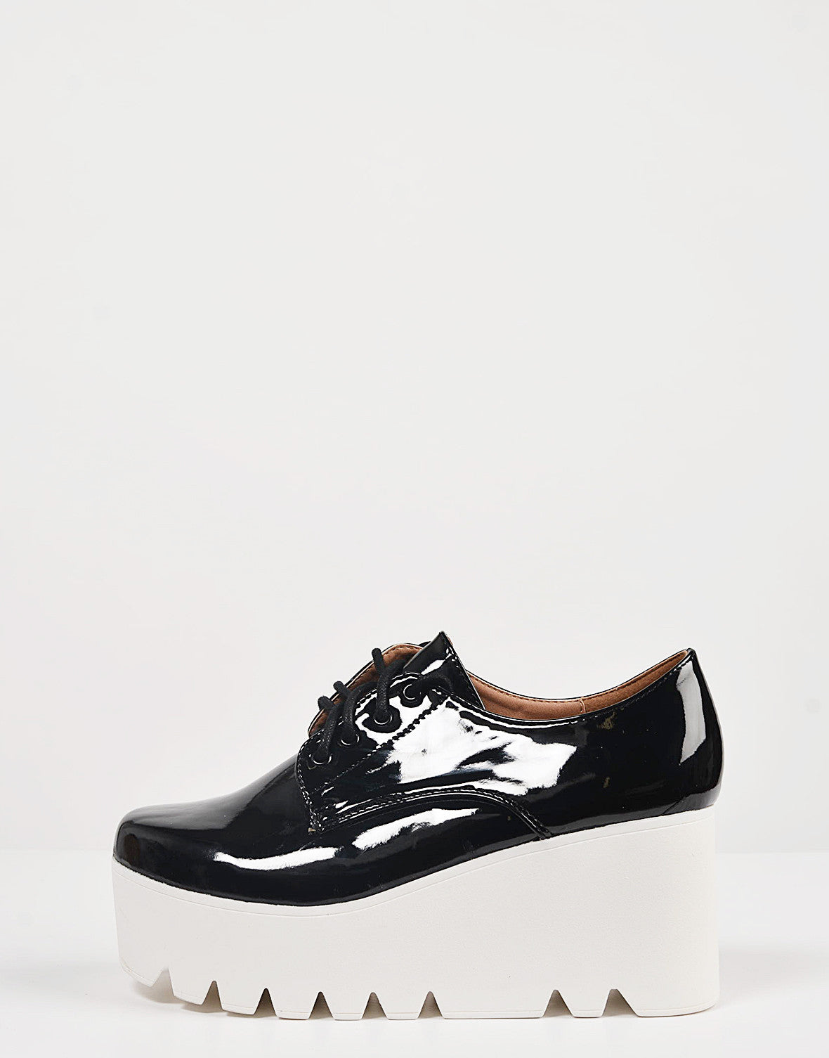 Side View of Patent Laced Up Flatform Oxfords