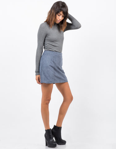 Side View of Perforated Suede Mini Skirt