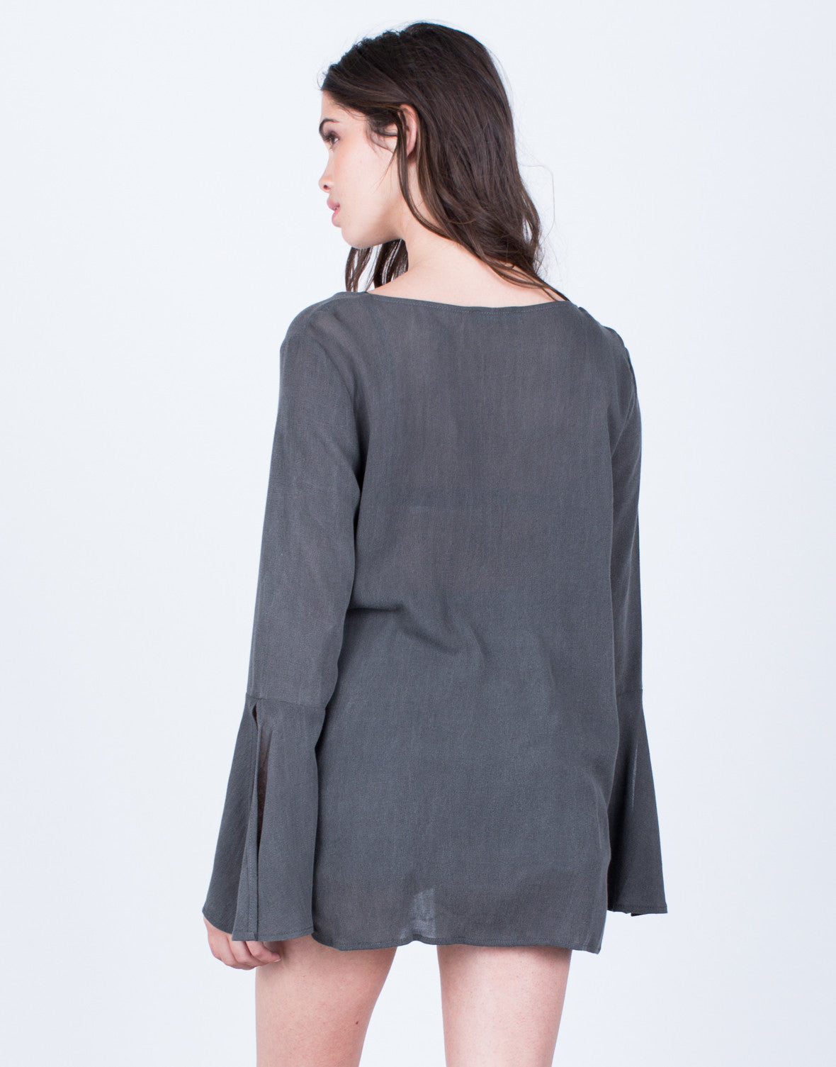 Back View of Plunging Bell Sleeve Blouse