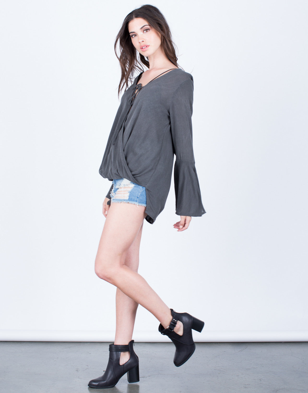 Side View of Plunging Bell Sleeve Blouse