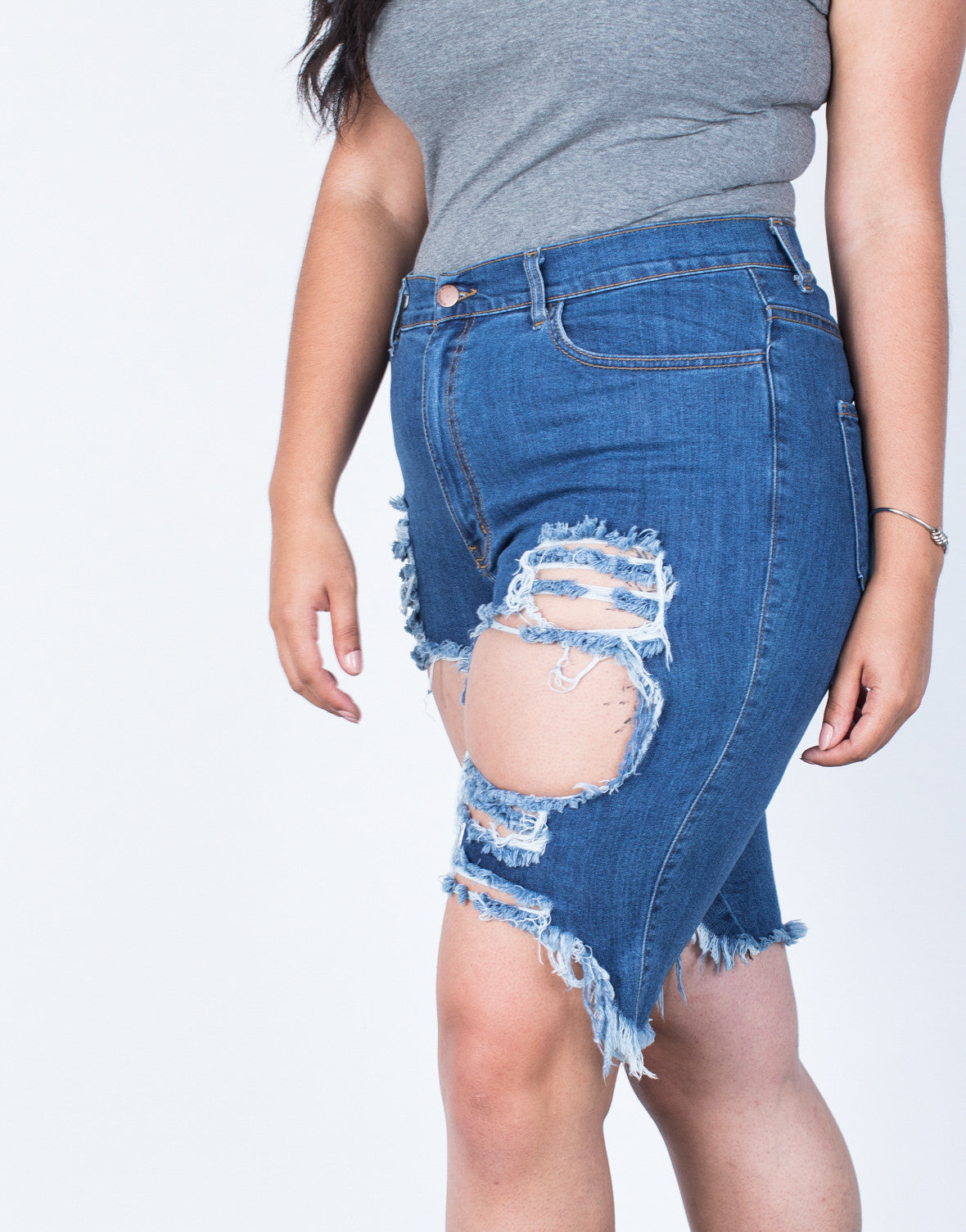 Detail of Plus Size Torn and Destroyed Bermuda Shorts
