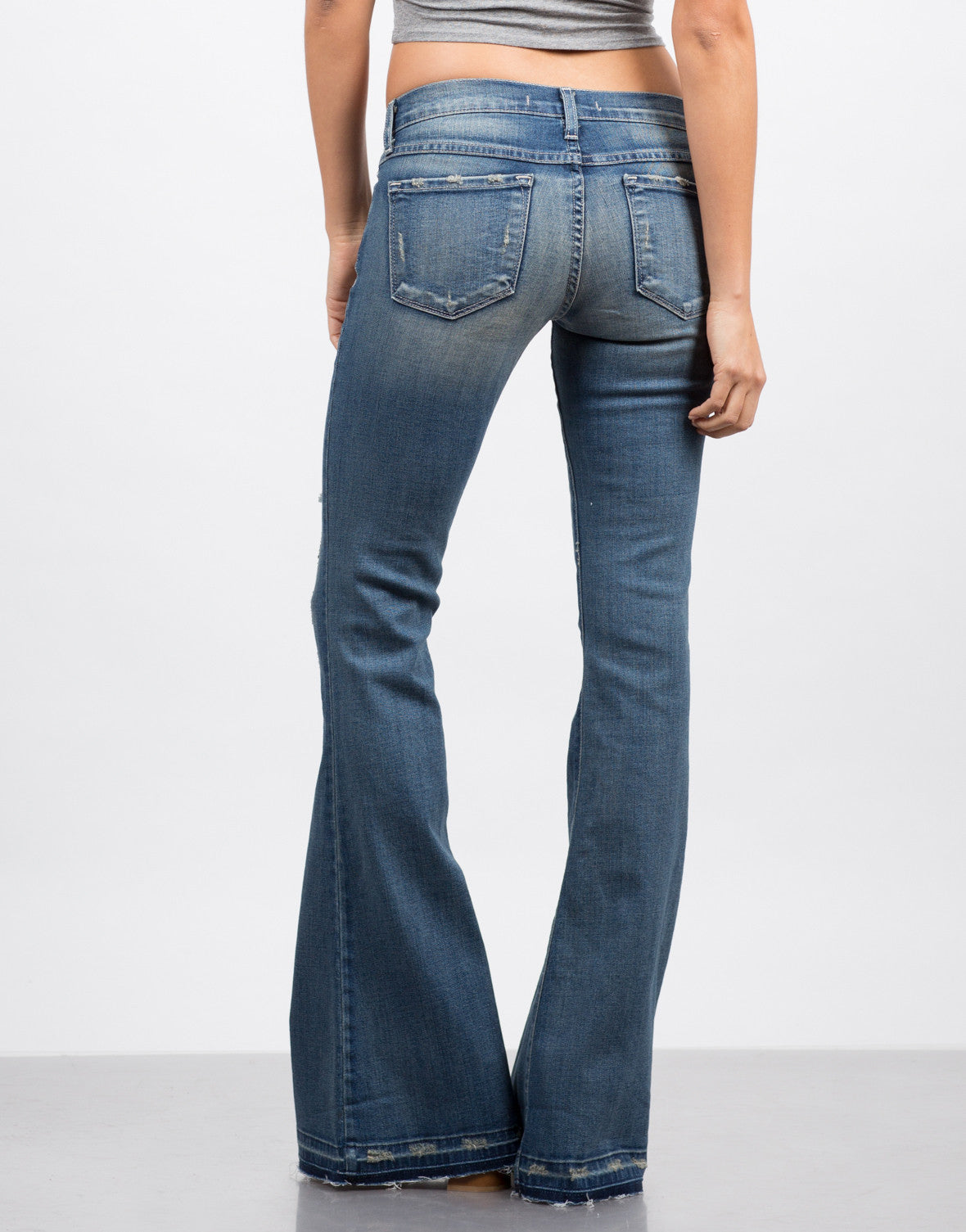 Back View of Released Hem Flared Jeans