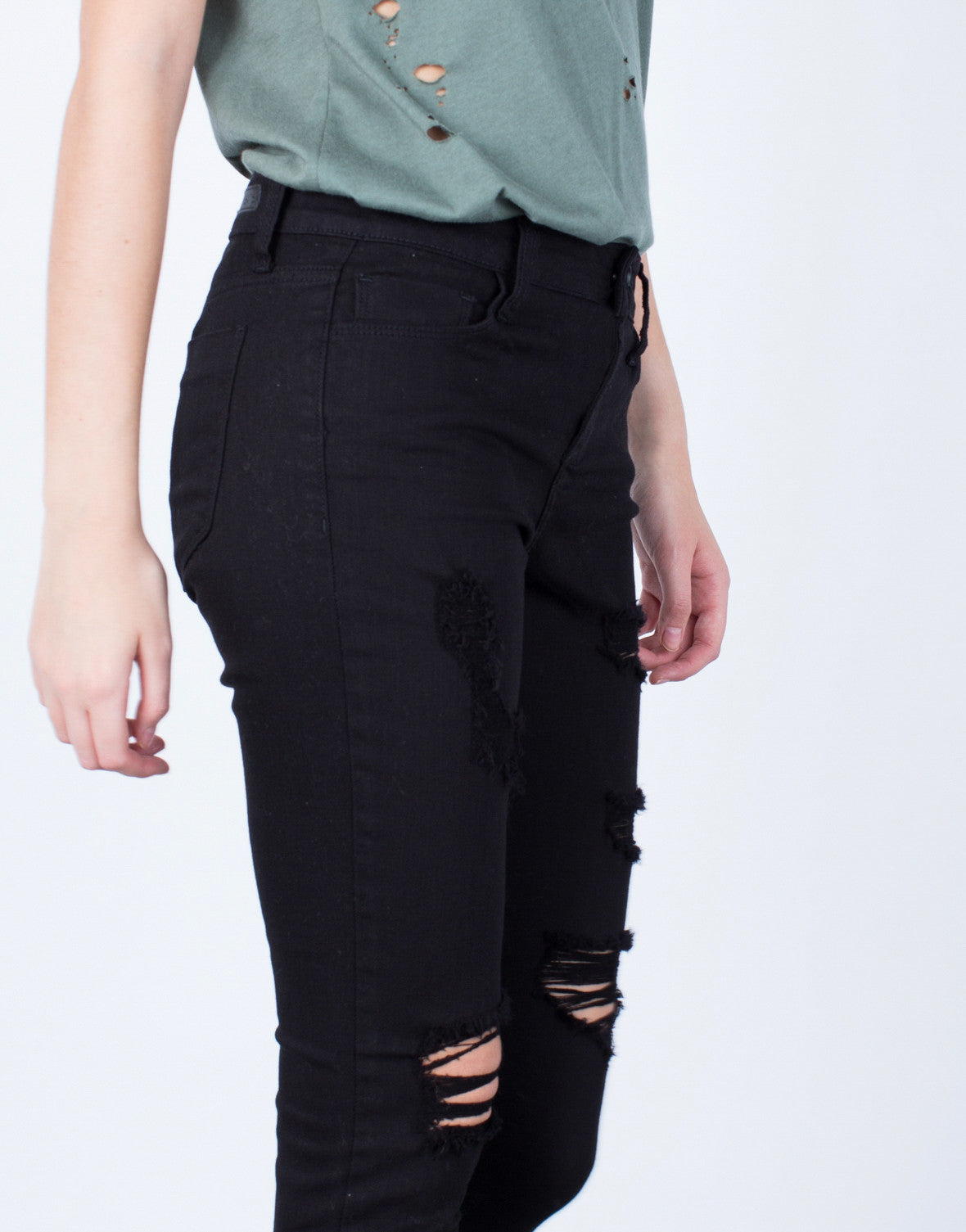 Detail of Ripped Black Denim Jeans