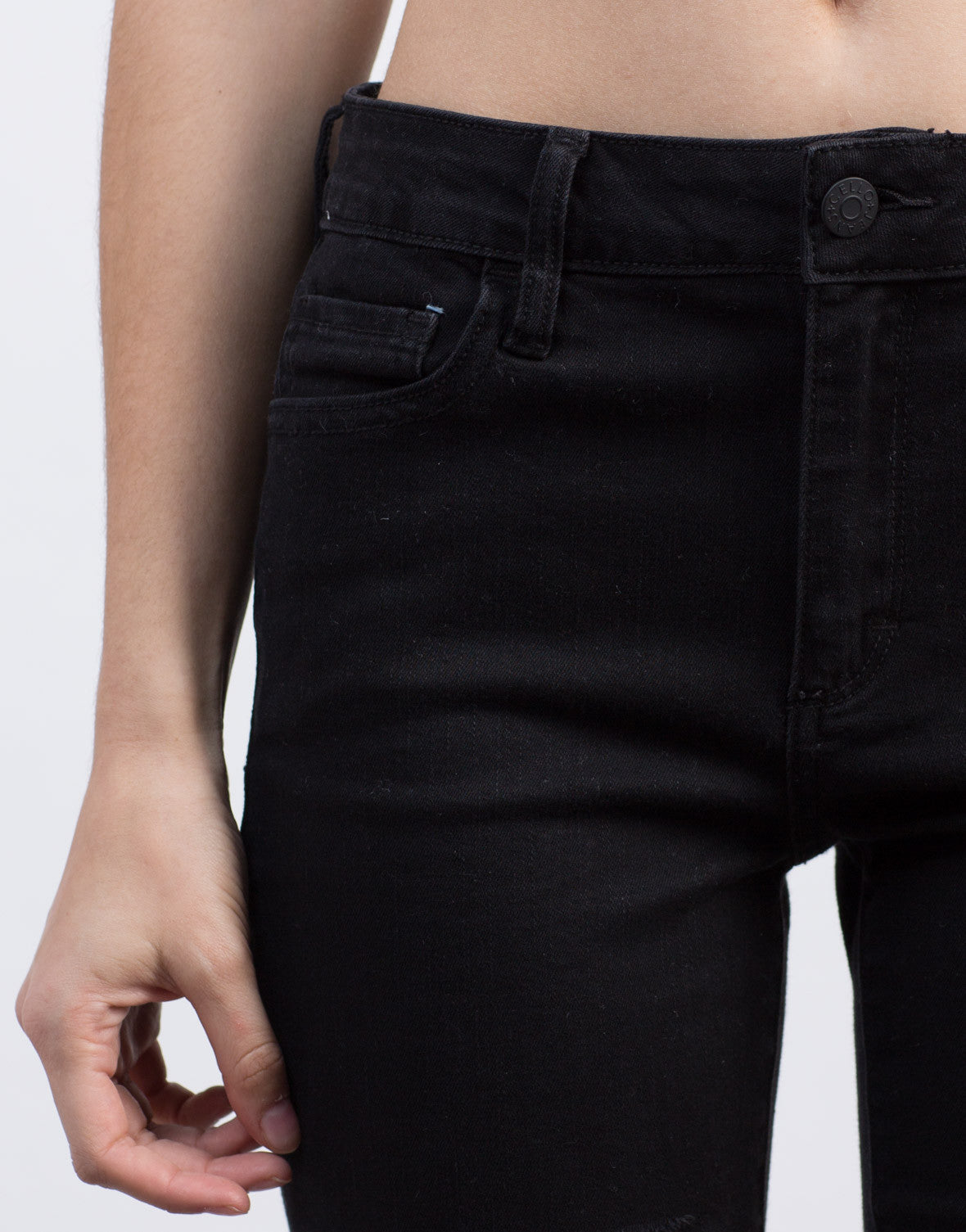 Detail of Ripped Black Skinny Jeans