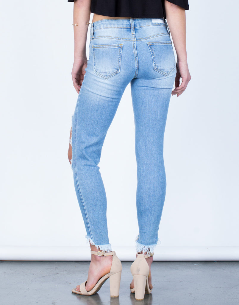 Back View of Ripped Knee Step Hem Jeans
